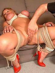 Blonde slave in bondage in...