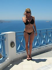 Kelly gives a blowjob by the pool in Santorini.