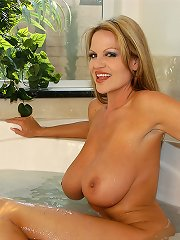 Kelly and her big tits take a bubble bath.