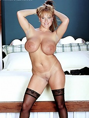 Busty porn celebrity shay laren teasing out of a black corset.
