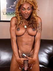 Smoking hot chocolate transsexual Natalia Coxxx posing