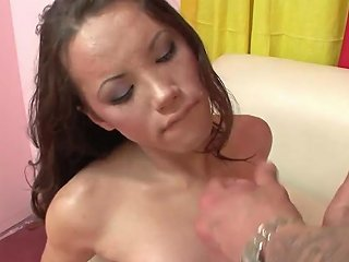 Brunette Tranny Babe Gets Analised On A White Sofa But