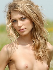 Zemani.com Lika - Blond beautiful angel with slim body poses naked on the spring field.
