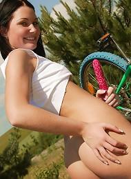 Teen cutie on a bike masturbates