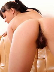 Pleasuring her soaked hairy muff