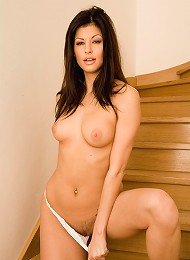 Sexy brunette fingers tight pussy on the stairs