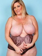 Big babe plays with her massive natural juggs