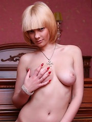 Beautiful blonde babe with natural big firm breasts