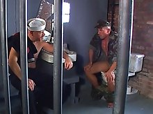 These two guys were unruly, so they were locked together to suck each other off