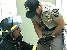 Fireman loves tasting a cop's cock