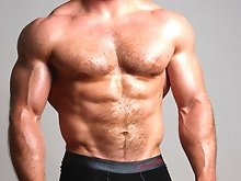 Big Hairy Muscle Stud Ben Kieren is oiled up and rock hard.