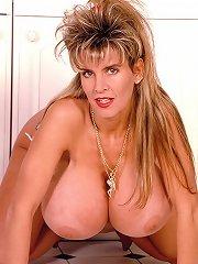 free boobs gallery Busty blonde strips inside...