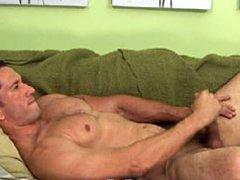 Muscle mature man shows his massive dick and masturbates