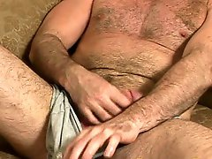 Muscle gay bear playing with his dick