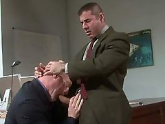 Mature gay daddy gives a head to a muscle hairy stud in suit