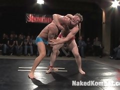 Two naked athletes fight and have sex in front of a live audience!