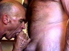 Hairy grandpa gets a big mature dick fed to his mouth while he's laying down