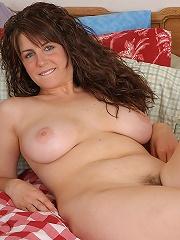 Tori strips to reavela big natural tits and a full bush