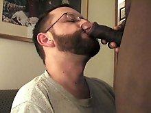 Bearded guy sucks an uncut dick