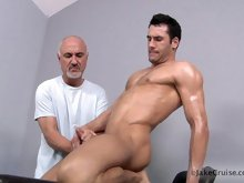Mature gay Jake pleases a hot hunk till he cums