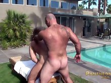 Two hairy muscle bears fucking doggy style outdoors