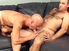 Horny male licking and sucking on guy's long hard cock