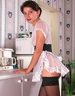 Sexy stockinged maid shows shes got no panties on