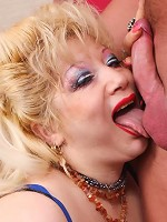Blonde plumper Zhanna holds on to her big breasts while she slides her lips all over a cock live