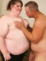 Flabby fatty riding a huge cock in the living room