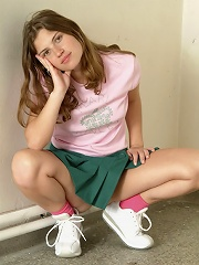Cute virgin schoolgirl toying her tight hole with a dildo.