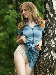 Hot blonde girl strips outdoors and shows her pussy