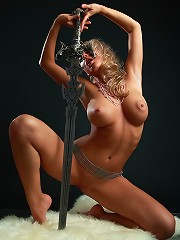 Sexy busty blonde posing with the real sword