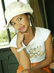 Teen Tussinee in a funky hat looks amazing!
