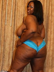 Hot and greased up ebony BBW Tina Taboo sucking off a black cock and takes cum glazing all over her face