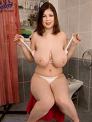 British solo girl faith in panties plays with her giant 36g genitals.