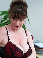 Huge breasted mature slut playing in the office