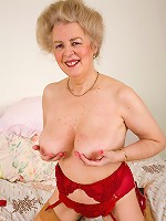 At 57 years old Busty still likes to play with her hairy muff