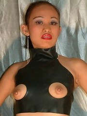 Small Asian cutie is dressed and ready to inflict pain