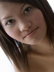 Light skinned Thai girl Fa posing nude...