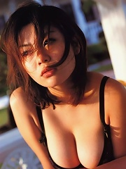 Steamy sultry asian chick with big full boobs in a bikini