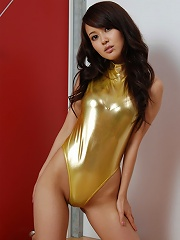 Gorgeous asian babe in a shimmering tight gold swim suit